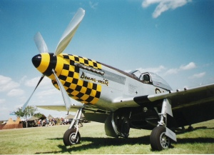 Picture of a Mustang airplane with yellow-checkered nose.