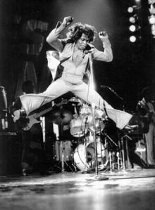 James Brown jumping into the air onstage