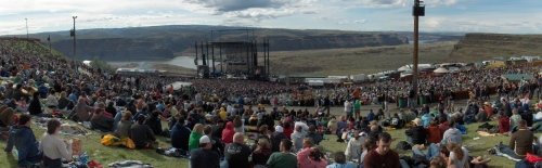 Panorama view of outdoor '70s-era rock concert
